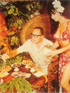 Postcard showing the owner, Trader Syd, being served at Luau in Miami Beach