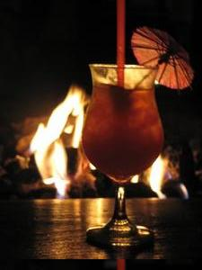 Drink and fireplace at Tiki Cocktail Lounge in Modesto