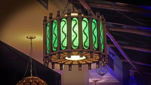 Lights on the mezzanine level in the main dining room at Jardin Tiki in Montreal