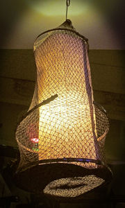 Light on the mezzanine level in the main dining room at Jardin Tiki in Montreal