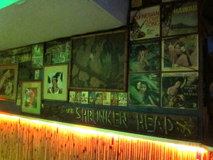 Art and albums on the wall at Otto's Shrunken Head in New York