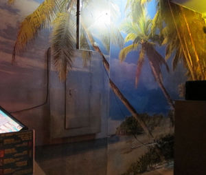 Beach scene mural at Otto's Shrunken Head in New York