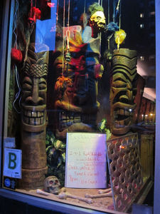 Tikis from Mai Tiki in the window at Otto's Shrunken Head in New York