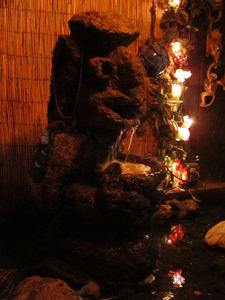 Stone tiki fountain at Tonga Hut in North Hollywood