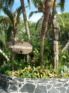 Sign and tiki near Adventureland entrance at The Enchanted Tiki Room in Orlando
