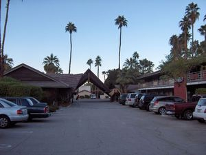 Looking from parking lot to the street at Caliente Tropics Resort in Palm Springs