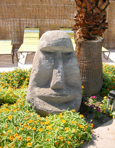 Stone tiki at Caliente Tropics Resort
