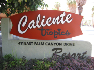 Caliente Tropics Resort sign