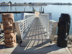 Tikis flank the boat dock at Bali Hai Restaurant in San Diego