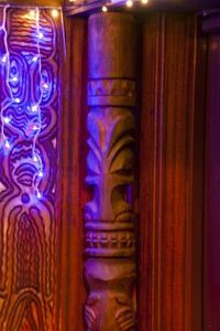 Tiki and carved wall panel near the entrance at Trader Vic's in Tokyo
