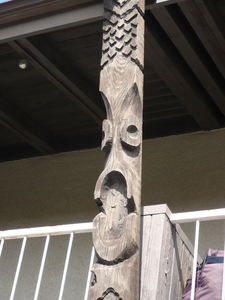 Carved tiki beam at Eli Kai Apartments in Torrance