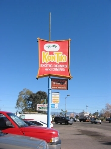 The sign for the Kon Tiki that is visible from the street