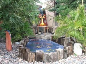 Tiki and pond in front of Kon Tiki Lounge in Tucson