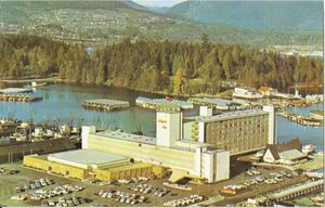 Postcard from Bayshore Inn in Vancouver, with the building for Trader Vic's at the lower right