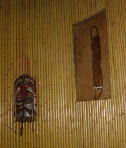 Tikis in the entrance stairwell at The Polynesian Room in Vancouver