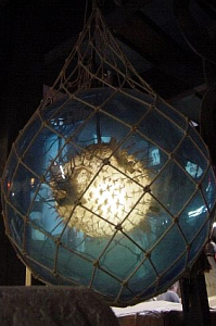 Perhaps the ultimate tiki lamp: a pufferfish inside a glass float, not for sale, at Oceanic Arts