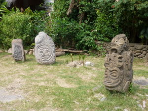 Stone tikis at Tiki Village Theater in Moorea