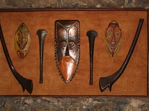 Masks and war clubs at The Islands Restaurant in San Diego