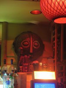 Tiki mask behind the bar at the Conga Lounge in Oakland