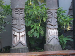 Palm tree tikis in front Harbor Hut in Morro Bay