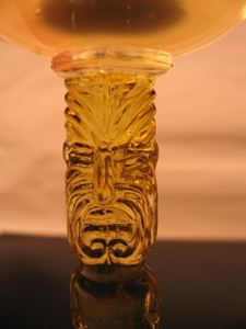 Detail of a tiki stem glass from Trader Vic's in St. Louis