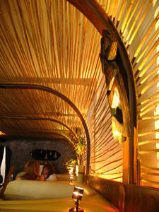 A bamboo-latticed arch and banquettes at Drift at Drift Lounge in Scottsdale
