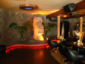 Moai guarding the dining room at Drift Lounge in Scottsdale
