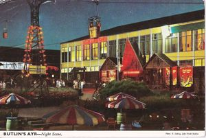 Postcard showing the nighttime exterior of Butlin's Beachcomber Bar in Ayr