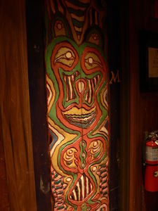 Carved panel on men's restroom door at Trader Vic's in Dallas