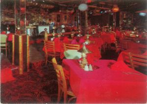 Detail of a postcard showing the dining room at Bob Brooks Seven Seas in Los Angeles