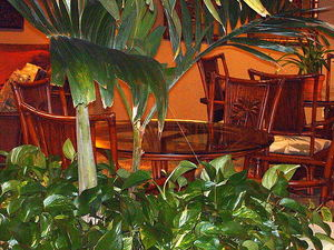 Hotel lounge seating near entrance to Traders Restaurant at Aku Tiki Inn in Daytona Beach