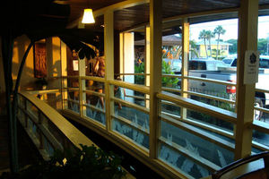 Bridge over koi pond, leading into the restaurant at Traders Restaurant in Daytona Beach
