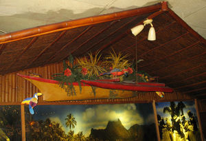 Canoe with birds and tropical plants suspended over the tables at Chan's Dragon Inn in Ridgefield
