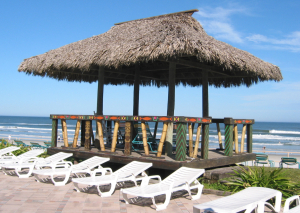 Lounging tiki hut between the pool and th ocean at Hawaiian Inn in Daytona Beach
