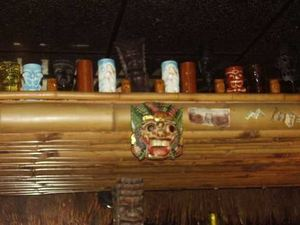 Tiki mugs on display behind the bar at Lava Lounge in Madison