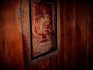 Carved wall art at Bahi Hut Lounge in Sarasota