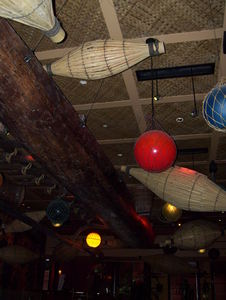 Outrigger on the ceiling with other flotsam and jetsam at Trader Vic's in San Francisco