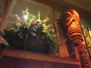 Tiki and floral arrangement at Trader Vic's in San Francisco