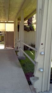 Simple tiki posts at Whispering Lakes Apartments in Ontario