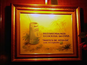 "Sign recommending the house cocktail ""Noites de Hiva-Oa"" at Bar Hiva-oa in Porto"
