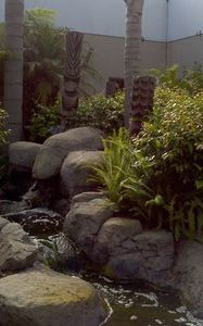Tikis and water feature in the central courtyard at Fry's Electronics in Manhattan Beach