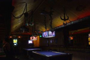 Purple-felted pool tables at Purple Orchid Exotic Tiki Lounge in El Segundo