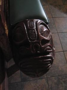 Carving on end of bench at Trader Vic's in Emeryville