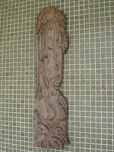 Carving in the pool area at Hawaiian Gardens in Lauderdale Lakes