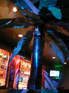 Metal palm tree at Smoke Tiki in San Jose