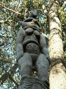 Carved figure atop pole at Papua New Guinea Sculpture Garden in Palo Alto