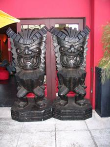 Two tikis at front entrance to Voodoo Room in Los Angeles