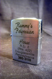 Vintage lighter from Rummy's Polynesian House in Monocacy