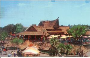 Postcard from Tahitian Terrace at Disneyland in Anaheim, showing the building and outdoor dining area