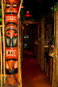 Seating sections and tiki at Hawaika in Valencia